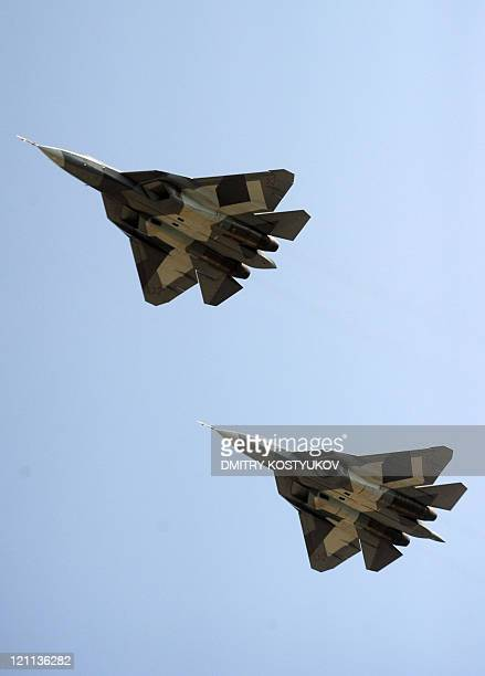New Russian twin-engine jet fighters T-50 fly over Zhukovsky airfield as it takes part in MAKS-2011, the International Aviation and Space Show, in...