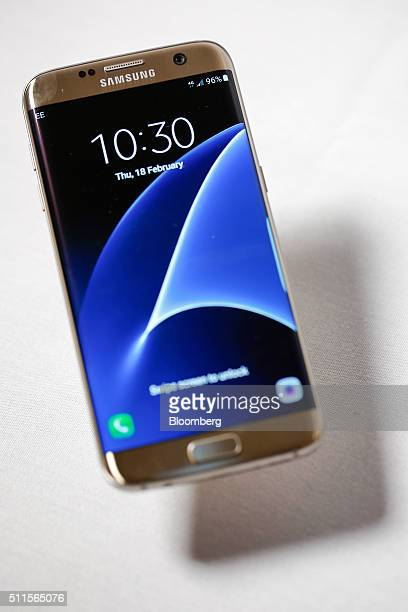A new Samsung Electronics Co Galaxy S7 edge with 3D thermo forming shows the display screen in this arranged photo in London UK on Thursday Feb 18...