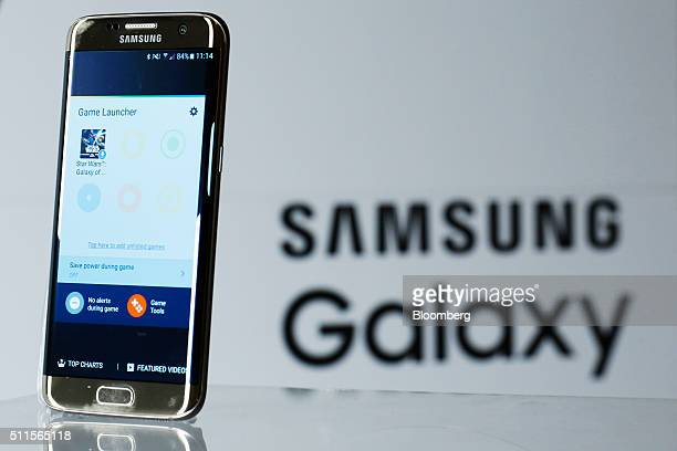 A new Samsung Electronics Co Galaxy S7 edge with 3D thermo forming displays the new software 'Game Launcher' page in this arranged photo in London UK...