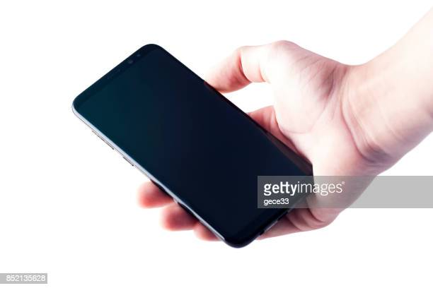 new samsung s8+ with human hand isolated on white - plus key stock photos and pictures