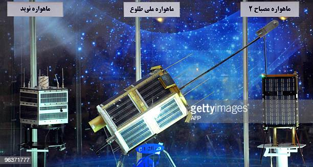 New satellites Navid Tolo Mesbah 2 are displayed during their unveiling ceremony in Tehran on February 3 2010 Iran hailed the successful launch of...