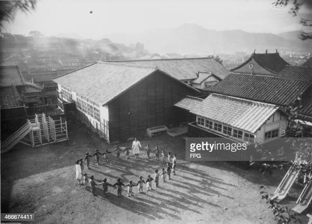 A new school in Nagasaki made up of pupils born just after the atomic bombings following World War Two Japan 1949