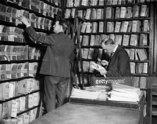 New Scotland Yard. Corner of storage of criminal records, and comparison of photographs. May 1929.