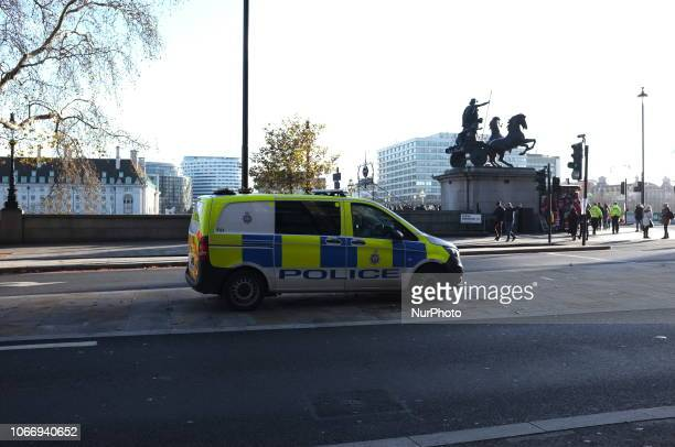 New Scotland Yard headquarters are pictured in London on November 30, 2018. Metropolitan Police is considering deploying armed officers on foot...