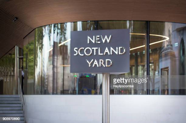 new scotland yard sign outside the new westminster hq on victoria embankment. - new scotland yard stock pictures, royalty-free photos & images