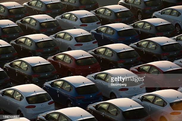 New Seat Leon automobiles stand beneath protective coverings in a parking lot ahead of shipping at Barcelona port in Barcelona Spain on Thursday Jan...