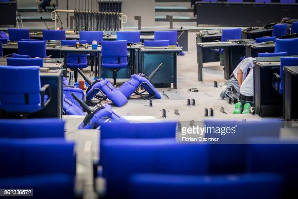 New seats for parliamentarians in the Bundestag are pictured during their installation at the Reichstag on October 17 2017 in Berlin Germany...