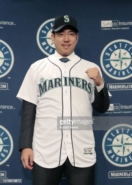 New Seattle Mariners pitcher Yusei Kikuchi poses in his uniform after his introductory press conference in Seattle on Jan 3 2019 The American League...
