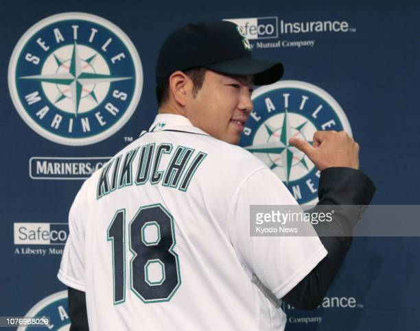 New Seattle Mariners pitcher Yusei Kikuchi poses in his uniform during his introductory press conference in Seattle on Jan 3 2019 The American League...