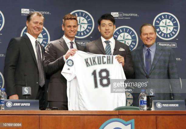 New Seattle Mariners pitcher Yusei Kikuchi poses with the team's General Manager Jerry Dipoto Manager Scott Servais and Kikuchi's agent Scott Boras...