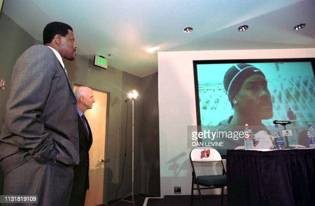 New Seattle SuperSonic Patrick Ewing and agent David Falk at a press conference in Seattle 25 September watch a video of SuperSonic Gary Payton being...