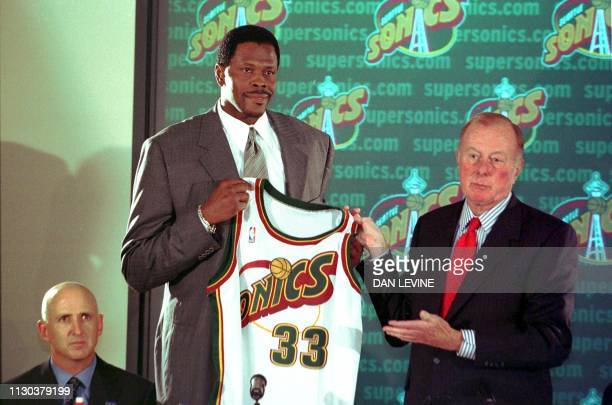 New Seattle SuperSonic Patrick Ewing is flanked by agent his David Falk and SuperSonic team owner Barry Ackerly as he is introduced at a press...