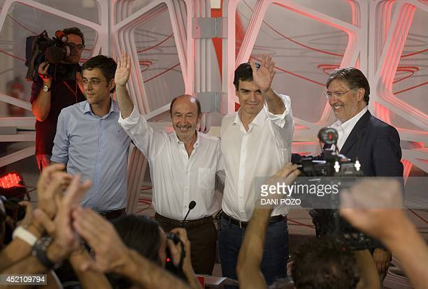 New secretary general of Spain's Socialist Party Pedro Sanchez celebrates his victory with his predecessor Alfredo Perez Rubalcaba and other...