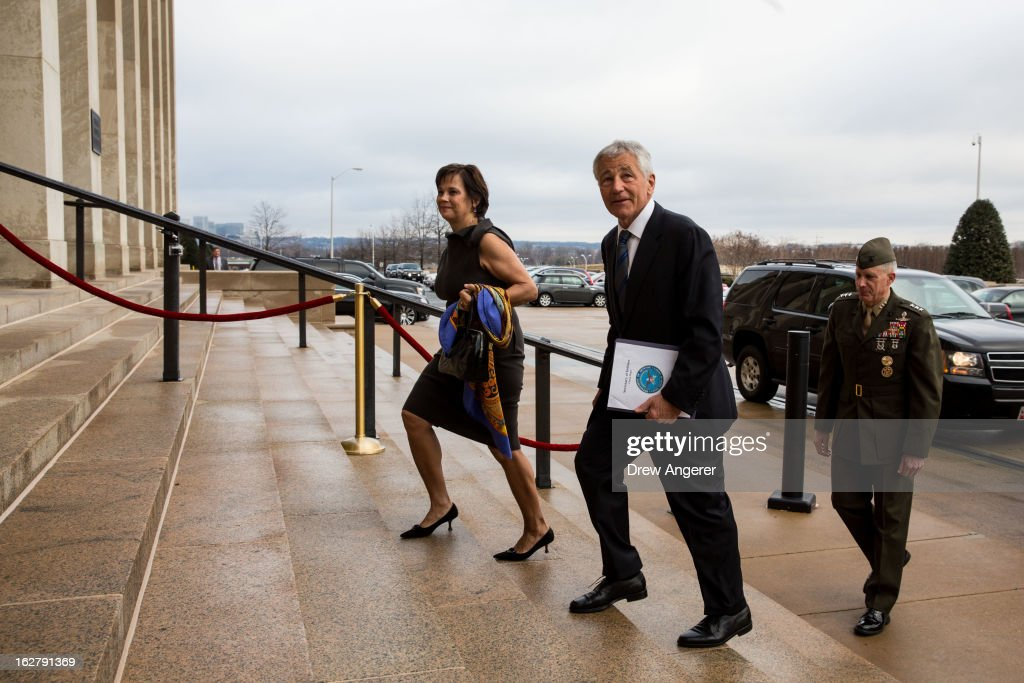 New Secretary of Defense Chuck Hagel, his wife Lilibet Hagel, and USMC Lt. General Thomas Waldhauser, who will serve as Hagel's Senior Private Military Assistant, arrive at the Department of Defense as Hagel begins his post as Defense Secretary, on February 27, 2013 in Arlington. Hagel will be sworn in Wednesday morning and deliver remarks to service members and employees later in the day.