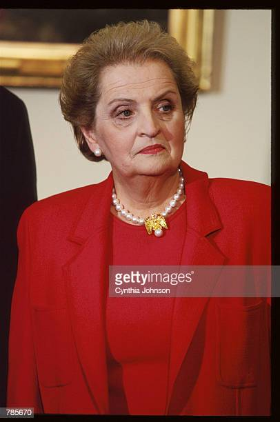 New Secretary of State Madeleine Albright stands in the Oval Office December 5 1996 in Washington DC President Bill Clinton announces his national...