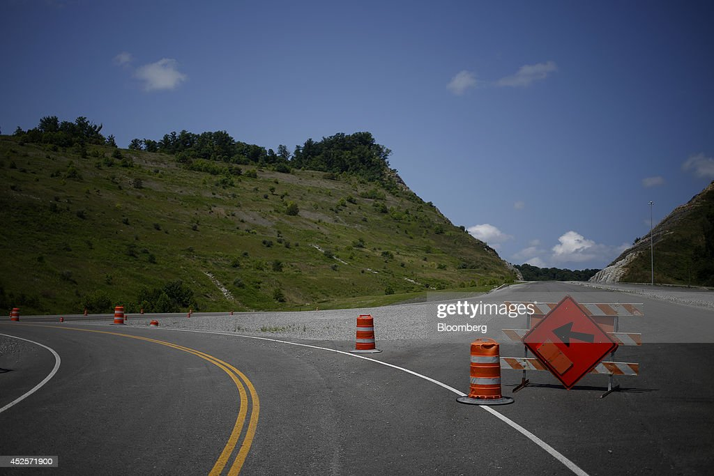 A new segment of U.S. Highway 460, part of the Appalachian Development Highway System, is pictured under construction near the Virginia border in Elkhorn City, Kentucky, U.S. on Tuesday, July 22, 2014. Senate Democrats may bring to the floor a House-passed measure that would replenish federal funds for highway and mass-transit projects through May 2015. As part of that debate, senators could vote on two Democratic alternatives, although leaders say the House measure is more likely to prevail. Photographer: Luke Sharrett/Bloomberg via Getty Images