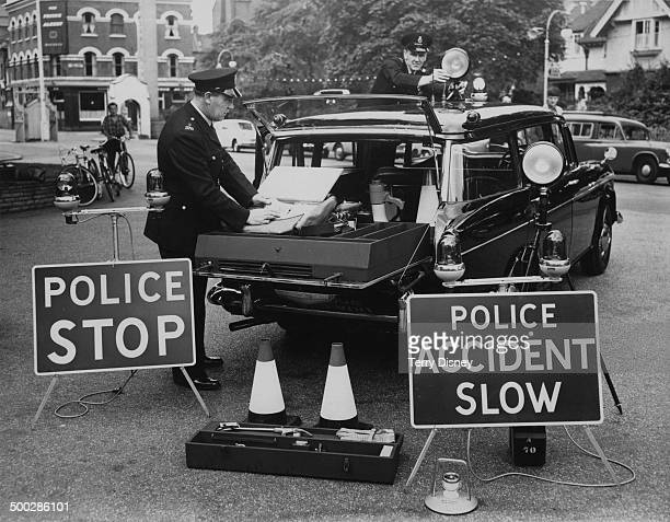 A new SETAC is demonstrated for the press by members of the Metropolitan Police at Battersea London 17th August 1961 The vehicle is a Humber estate...
