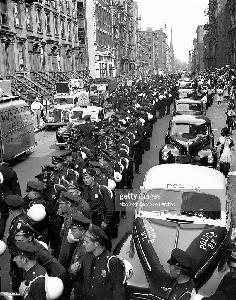 New shift of Police lined up in West 123d St. on August 2, 1943 in Harlem, New York is new force of police to take over from those who had been on duty all night. At one time during Harlem disorders there were 6,000 cops on duty in that area.