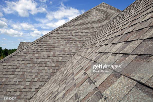 new shingled roof with blue sky background - roof stock photos and pictures