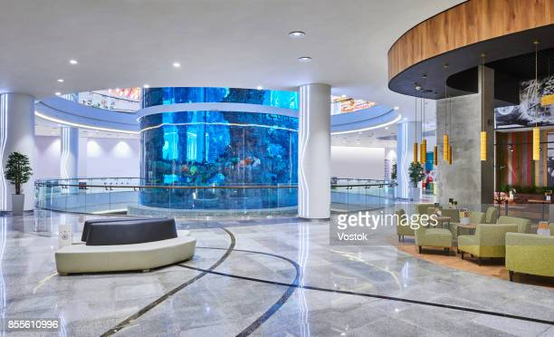new shopping mall in moscow with the biggest aquarium in the centre - shopping mall stock pictures, royalty-free photos & images