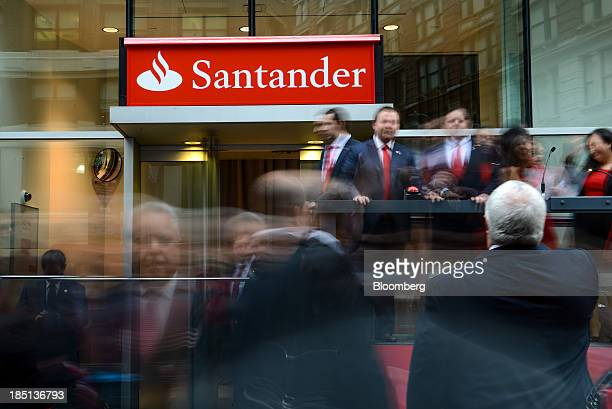 A new sign is unveiled during an event to rebrand Sovereign Bank NA to Santander at the company's first bank branch in New York US on Thursday Oct 17...