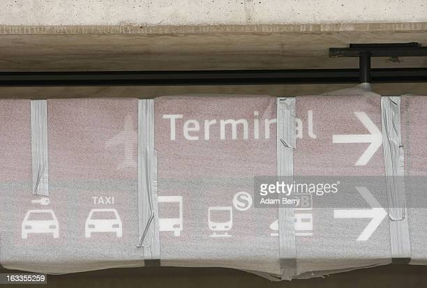 A new sign remains covered outside of the main terminal building at the stillunopened Berlin Brandenburg International airport on March 8 2013 in...