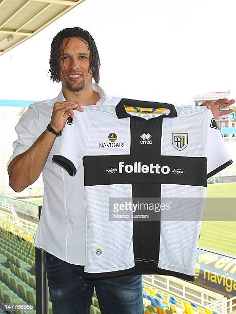New signing Amauri Carvalho De Oliveira presents the new team shirt during a press conference at Stadio Ennio Tardini on July 3 2012 in Parma Italy