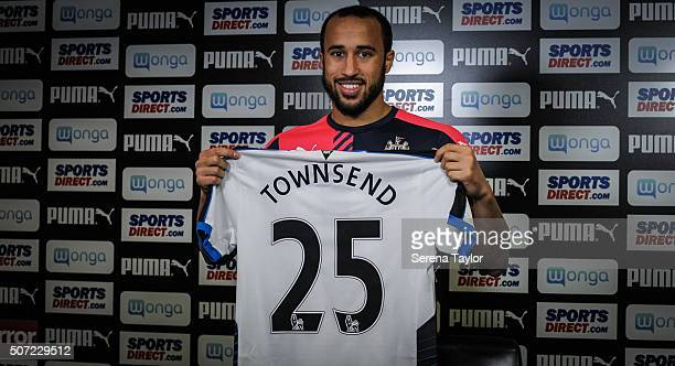 New Signing Andros Townsend holds up his named and numbered shirt in a press conference at The Newcastle United Training Centre on January 28 in...