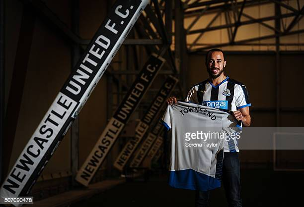 New Signing Andros Townsend poses for photographs holding a Newcastle United Named Shirt on the indoor training pitch at The Newcastle United...