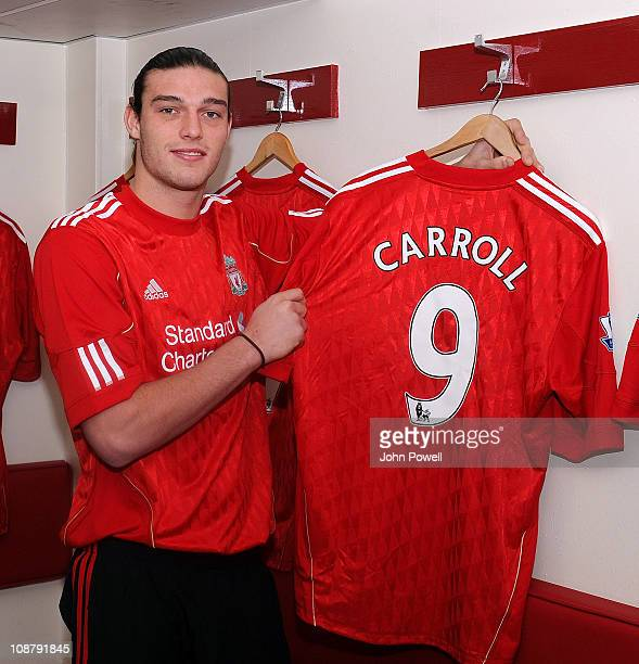 New signing Andy Carroll of Liverpool poses with his shirt at Anfield on February 3 2011 in Liverpool England