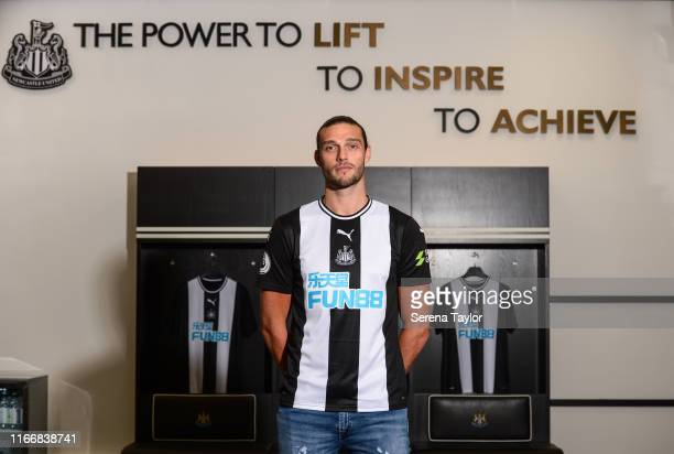 New signing Andy Carroll poses for photographs at StJames' Park during a photocall on August 08 2019 in Newcastle upon Tyne England