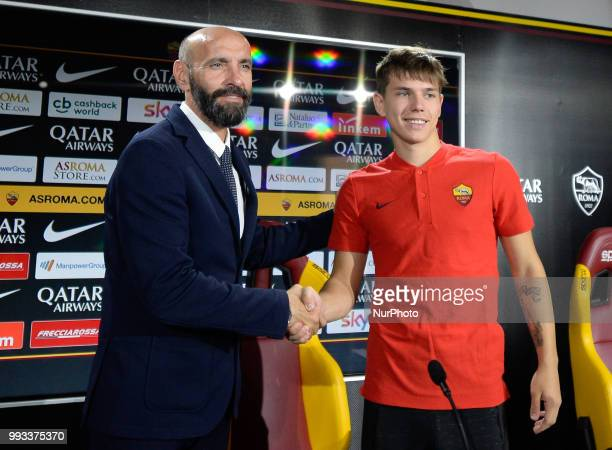 New signing Ante Coric and Sport Director Ramon Rodriguez Verdejo Monchi pose for photographers during the press conference at the AS Roma Training...