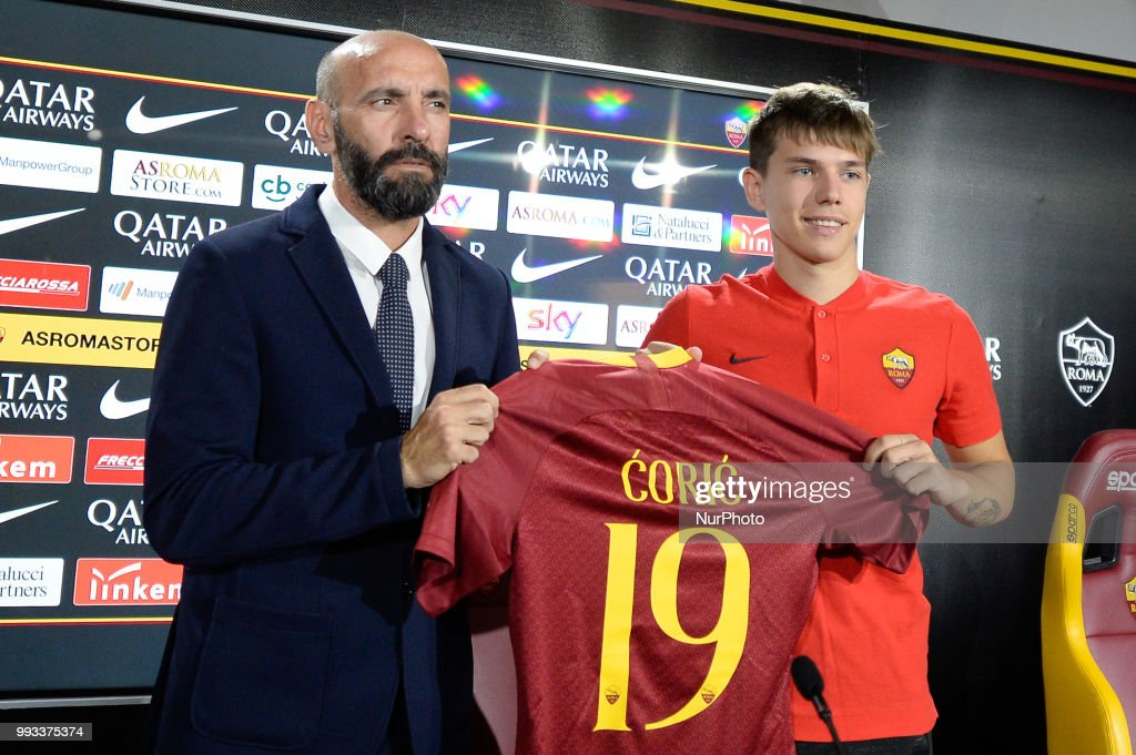 New signing Ante Coric and Sport Director Ramon Rodriguez Verdejo Monchi pose for photographers with AS Roma Shirt during the press conference at the AS Roma Training Centre on July 07, 2018 in Rome, Italy.