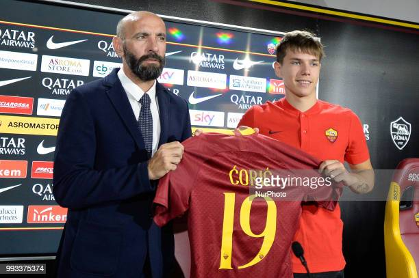 New signing Ante Coric and Sport Director Ramon Rodriguez Verdejo Monchi pose for photographers with AS Roma Shirt during the press conference at the...