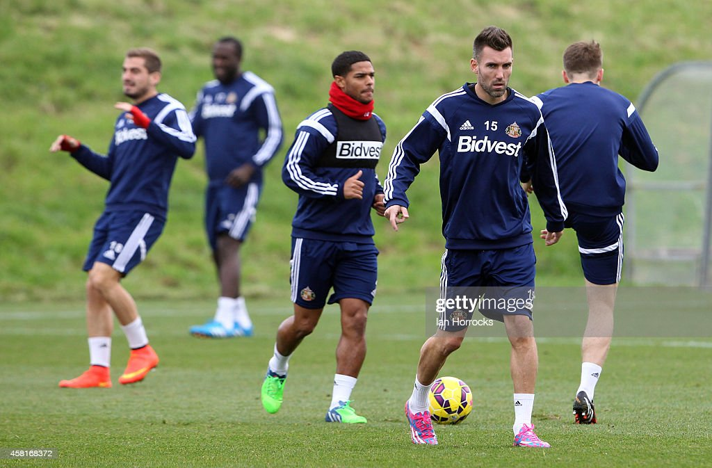 New signing Anthony Reveillere (R) during a Sunderland AFC Training Session at The Academy of Light on October 31, 2014 in Sunderland, England.