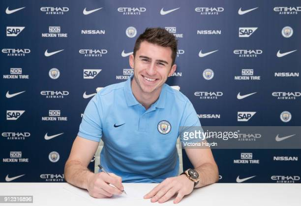 New signing Aymeric Laporte takes part in the official signing photo at Manchester City Football Academy on January 30 2018 in Manchester England