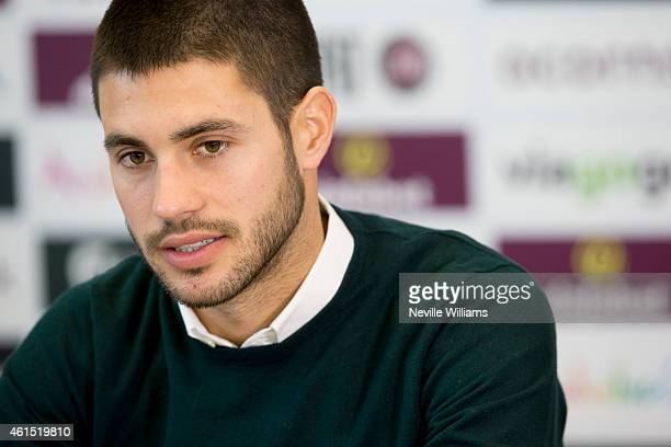 New signing Carles Gil of Aston Villa talks to the press at a press conference at the club's training ground at Bodymoor Heath on January 14 2015 in...