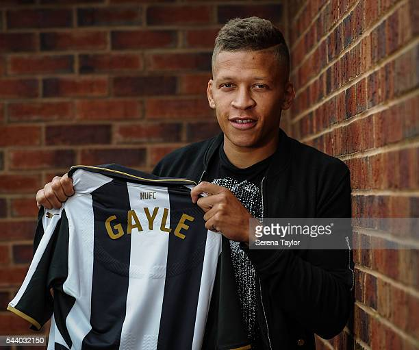 New signing Dwight Gale poses for a photograph holding a named shirt at The Newcastle United Training Centre on June 30 2016 in Newcastle upon Tyne...
