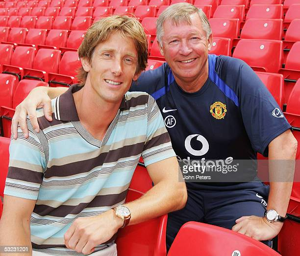 New Signing Edwin van der Sar poses with Sir Alex Ferguson after a Manchester United Press Conference at Old Trafford on July 13, 2005 in Manchester,...