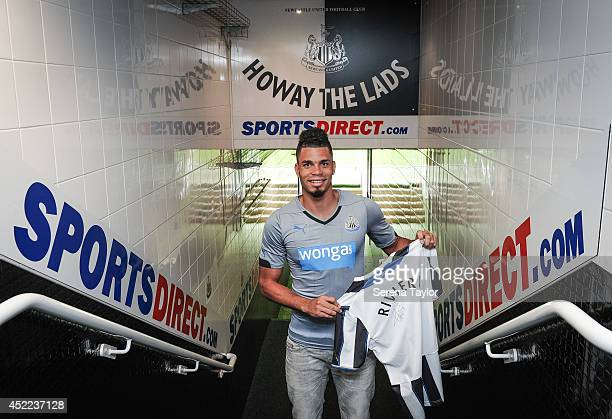 New signing Emmanuel Riviere poses for photographs in the tunnel holding a Newcastle shirt at St.James' Park on July 16, 2014 in Newcastle upon Tyne,...