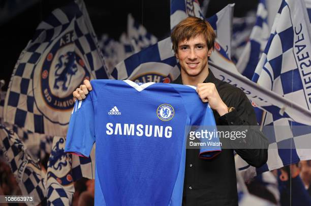 COVERAGE*** New signing Fernando Torres holds a Chelsea shirt as he signs for Chelsea FC at Stamford Bridge on January 31 2011 in London England