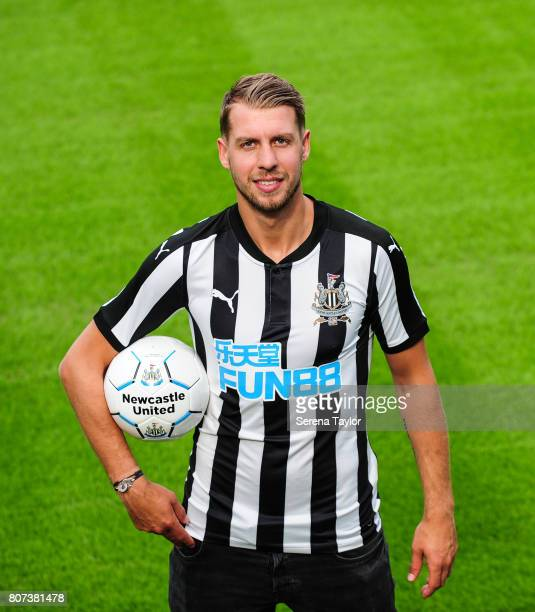 New Signing Florian Lejeune poses for photographs holding a ball on the pitch at StJames Park on July 3 in Newcastle upon Tyne England