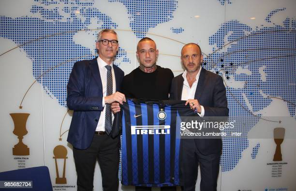 New signing for FC Internazionale Milano Radja Nainggolan signs his contract with Sportif Director of FC Internazionale Milano Piero Ausilio and...