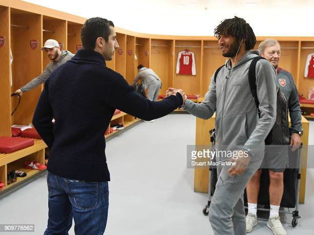 New signing Henrikh Mkhitaryan shakes hands with Mohamed Elneny in the Arsenal changing room before the Carabao Cup SemiFinal Second Leg between...
