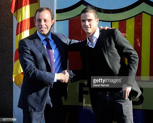 New signing Ibrahim Afellay and FC Barcelona President Sandro Rosell shake hands during his presentation as new FC Barcelona player at Camp Nou on...