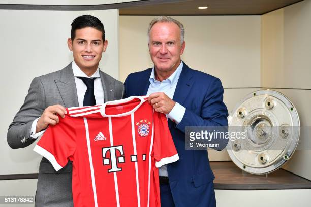 New signing James Rodriguez of FC Bayern Muenchen and KarlHeinz Rummenigge CEO of FC Bayern Muenchen pose with a FC Bayern Muenchen jersey at...