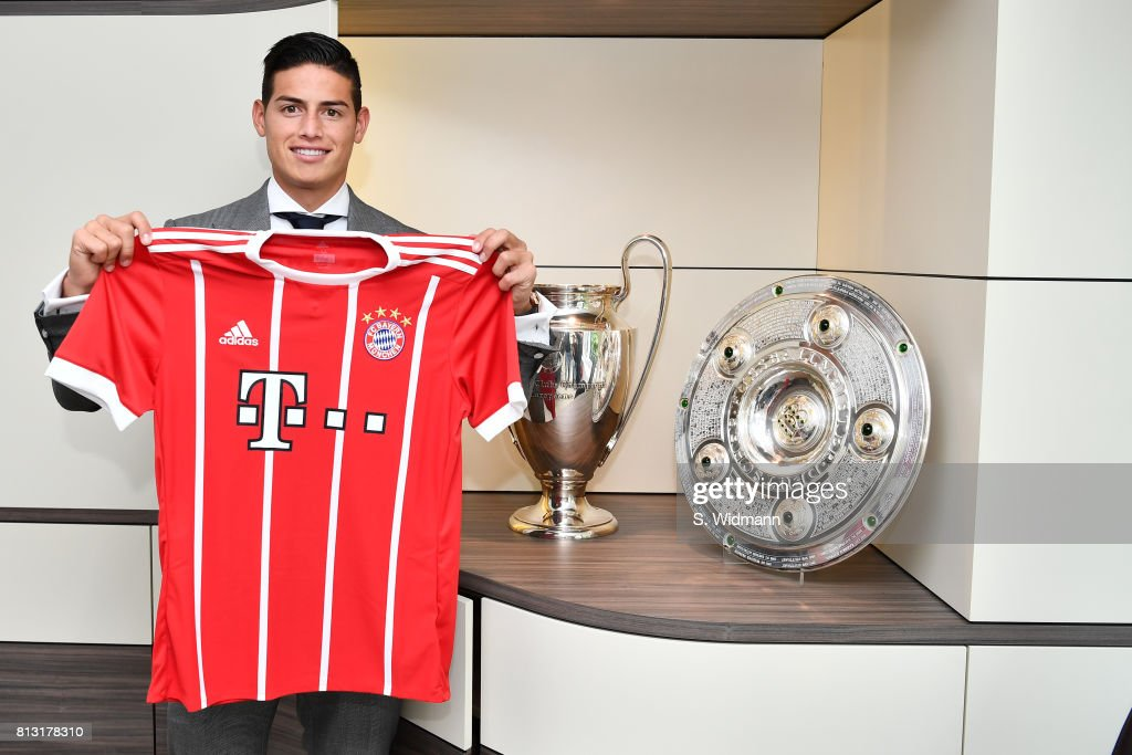 New signing James Rodriguez poses with a FC Bayern Muenchen jersey at Saebener Strasse training ground on July 12, 2017 in Munich, Germany.