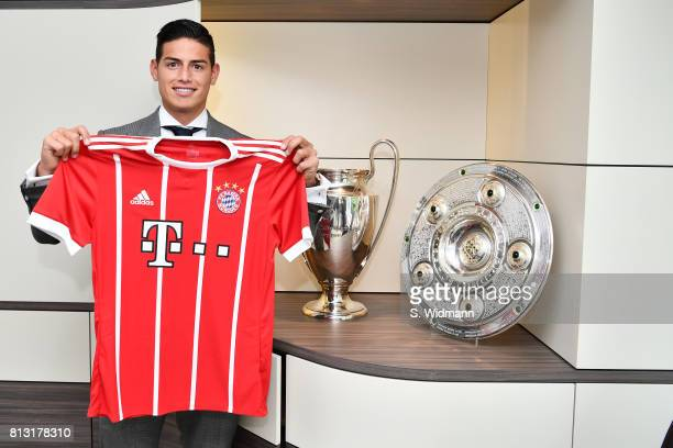 New signing James Rodriguez poses with a FC Bayern Muenchen jersey at Saebener Strasse training ground on July 12 2017 in Munich Germany