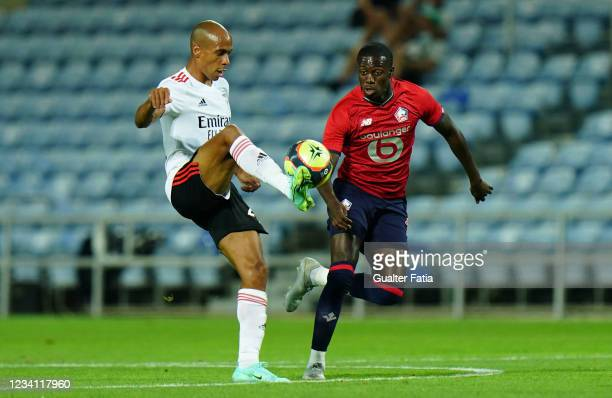 New signing Joao Mario of SL Benfica with Timothy Weah of LOSC Lille in action during the Pre-Season Friendly match between SL Benfica and Lille at...