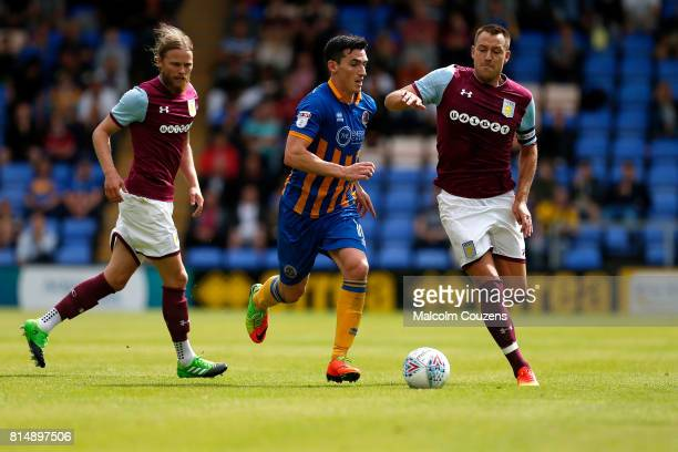 New signing John Terry of Aston Villa competes with Louis Dodds of Shrewsbury Town during the PreSeason Friendly between Shrewsbury Town and Aston...